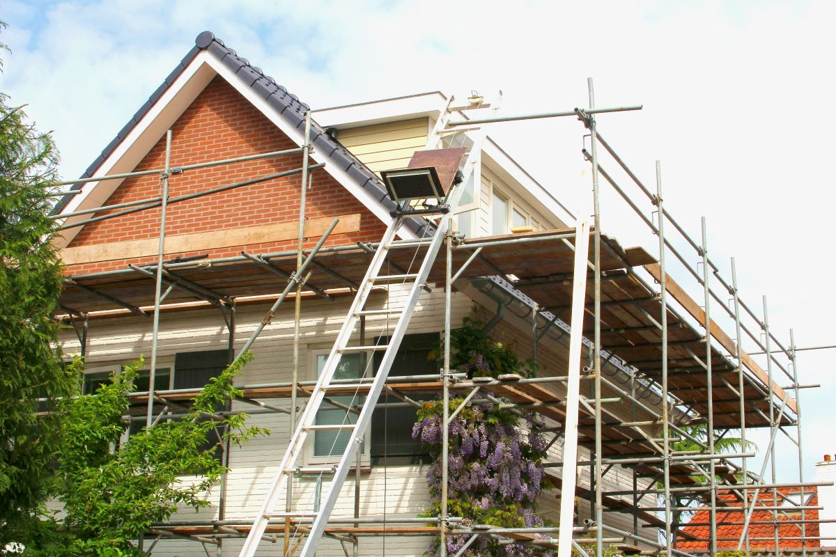 house with scaffolding outside under renovation