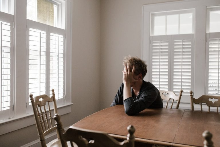 man stressed out at the dinner table