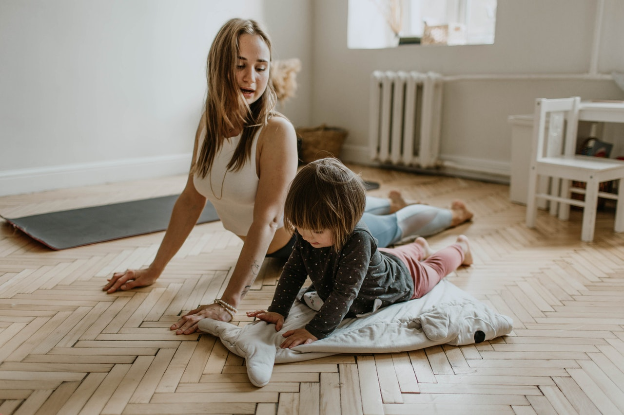 woman doing some exercise with her child