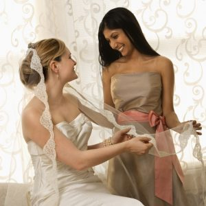 maid of honor assisting bride